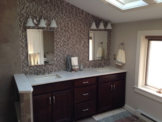 tiled bathroom vanity with wood cabinets
