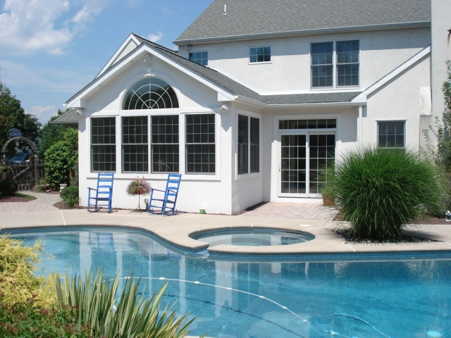 Florida room installed for home outside swimming pool